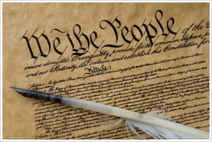 We the people American Constitution with feather pen