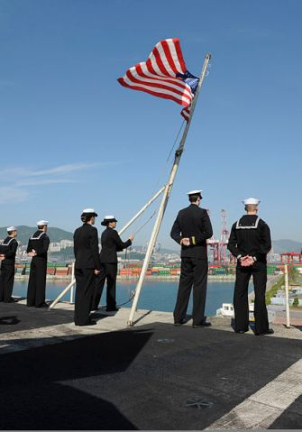 U.S._Sailors_raise_the_American_flag_aboard_the_aircraft_carrier_USS_Nimitz_(CVN_68)_as_the_ship_arrives_in_Busan,_South_Korea,_May_11,_2013,_for_a_scheduled_port_visit_130511-N-KE148-304 - Copy